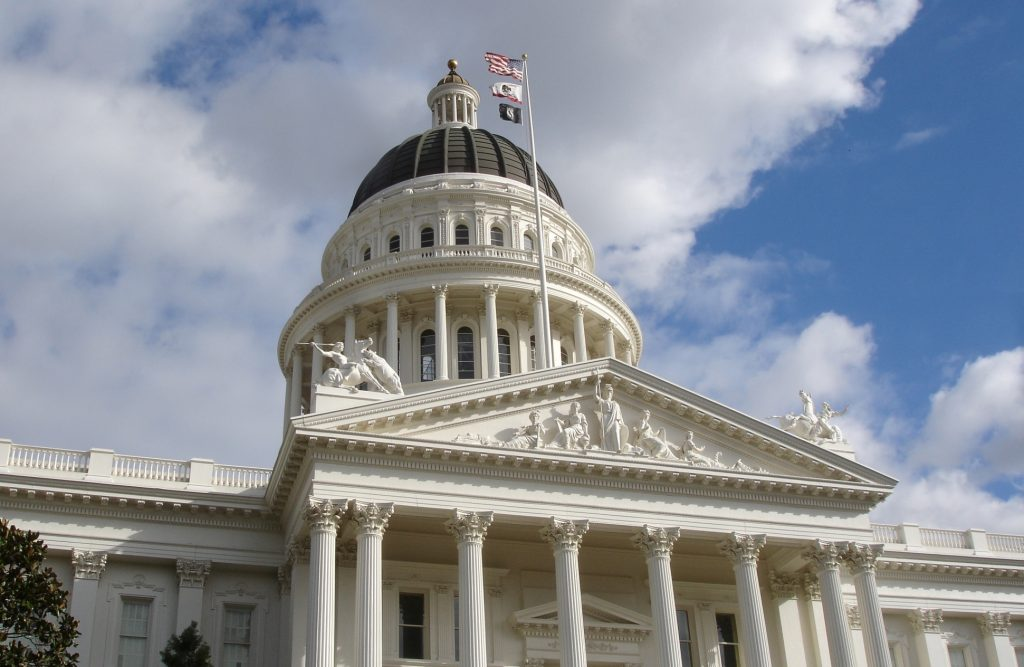 California State Capitol building Sacramento with flags